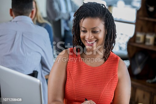 694187664 istock photo African American professional woman working remotely from coffee shop 1071258408