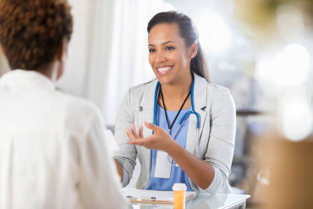 african american reviews prescription medication with patient - doctors and nurses stock photos and pictures