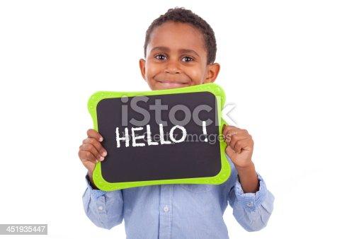 istock African American school boy holding a blank black board 451935447