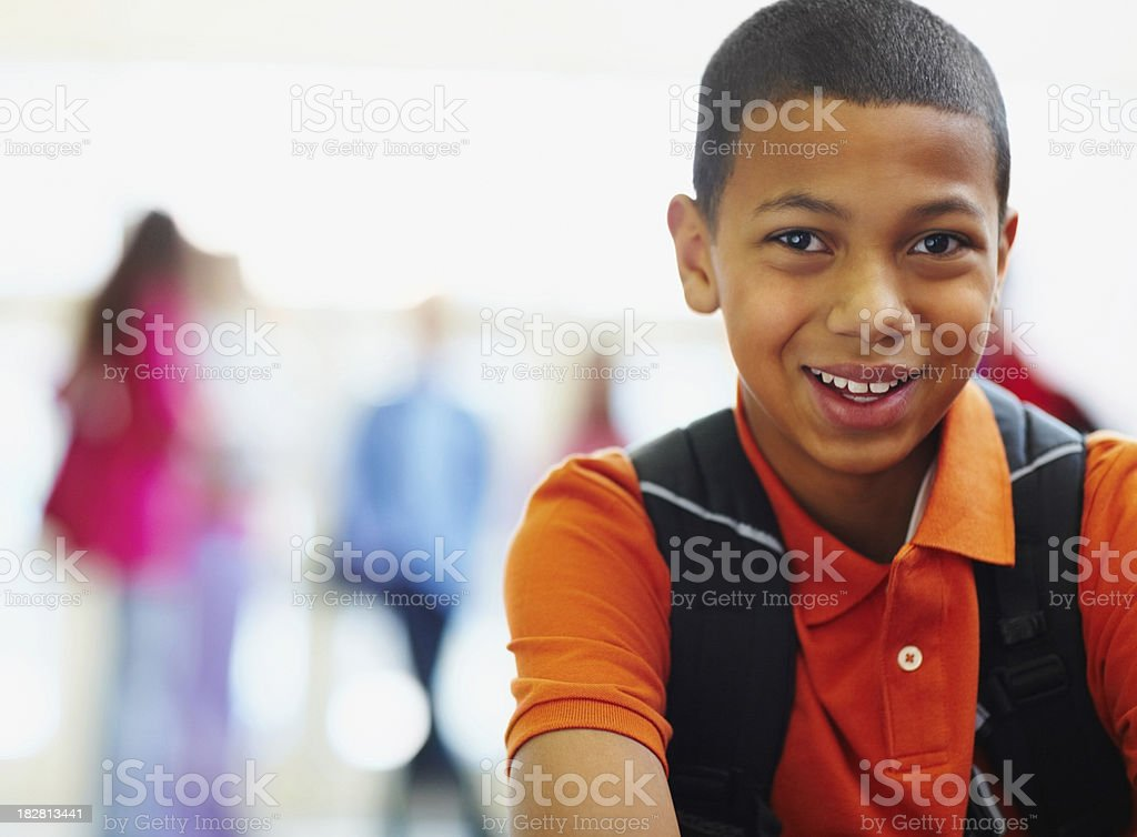 African American school boy with friends in the background stock photo