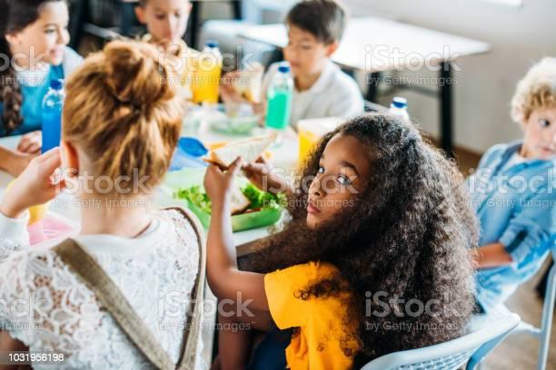 African american schoolgirl taking lunch at school cafeteria with her picture id1031956198?b=1&k=6&m=1031956198&s=612x612&h=u4alaabdo6f oti7kpbilb3o9h8uz30tgnhzg75ehvk=