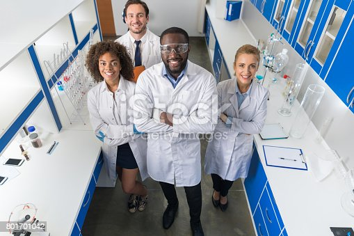 istock African American Scientist With Group Of Researchers In Modern Laboratory Happy Smiling, Mix Race Team Of Scientific Researchers In Lab 801701042