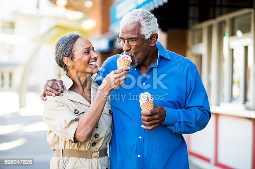 istock African American Senior Couple On the Town with Ice Cream 898247826