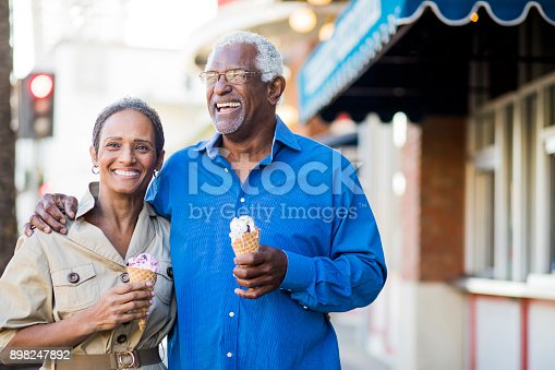 istock African American Senior Couple On the Town with Ice Cream 898247892