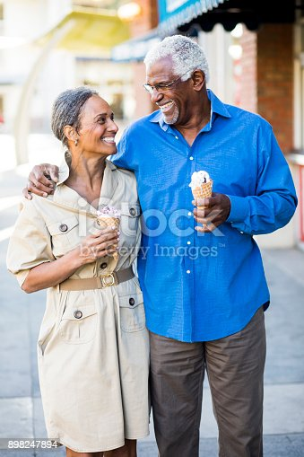 istock African American Senior Couple On the Town with Ice Cream 898247894