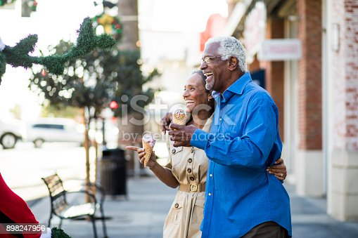 istock African American Senior Couple On the Town with Ice Cream 898247956