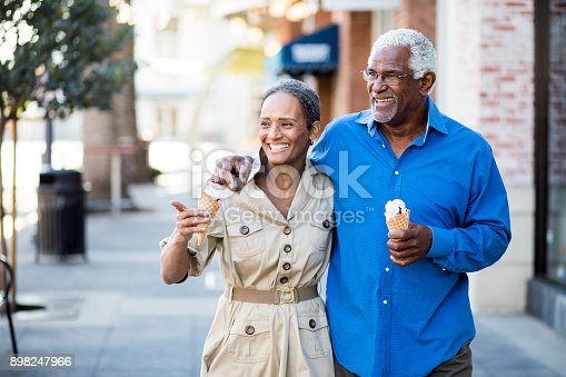istock African American Senior Couple On the Town with Ice Cream 898247966