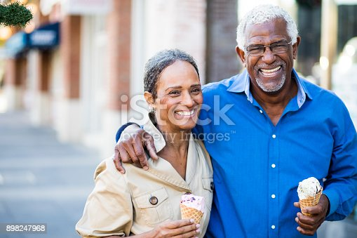 istock African American Senior Couple On the Town with Ice Cream 898247968