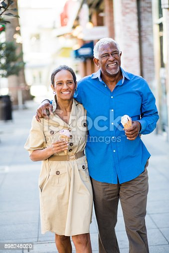 istock African American Senior Couple On the Town with Ice Cream 898248020