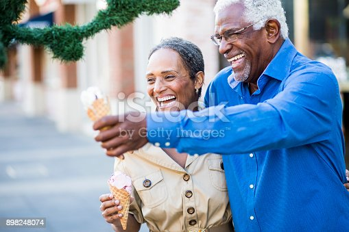 istock African American Senior Couple On the Town with Ice Cream 898248074