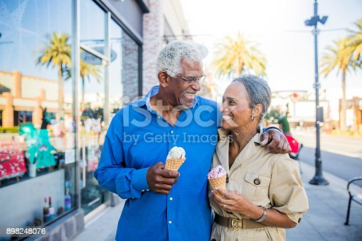 istock African American Senior Couple On the Town with Ice Cream 898248076