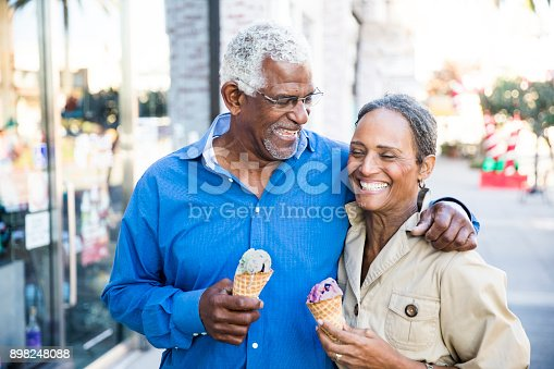 istock African American Senior Couple On the Town with Ice Cream 898248088