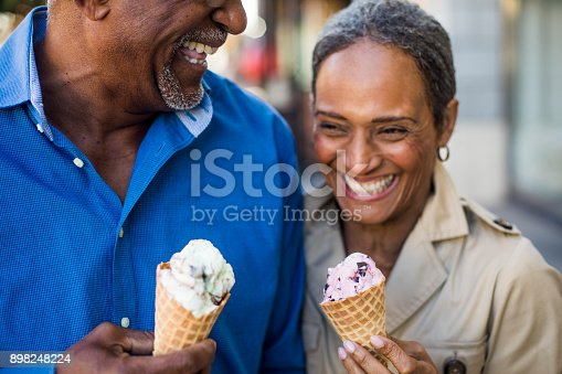898248356 istock photo African American Senior Couple On the Town with Ice Cream 898248224
