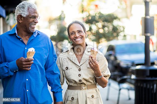istock African American Senior Couple On the Town with Ice Cream 898248258
