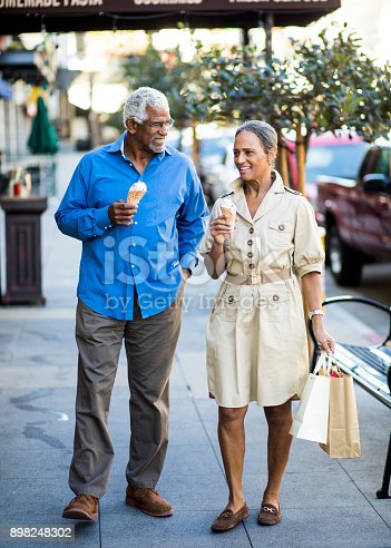 istock African American Senior Couple On the Town with Ice Cream 898248302