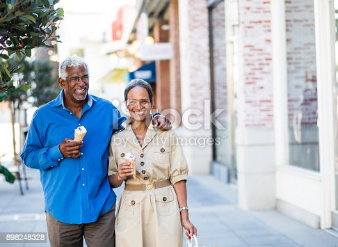 istock African American Senior Couple On the Town with Ice Cream 898248328