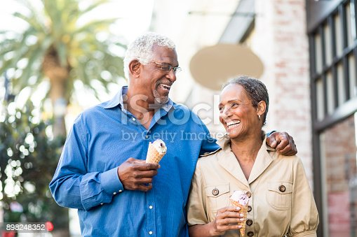 istock African American Senior Couple On the Town with Ice Cream 898248352