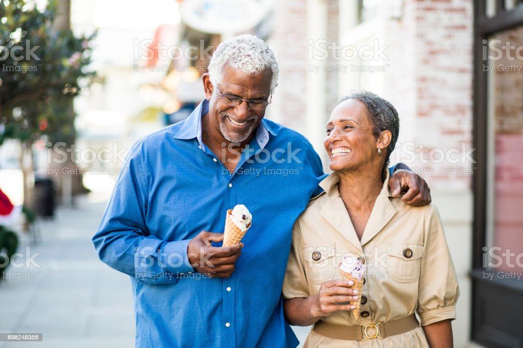 African American Senior Couple On the Town with Ice Cream stock photo