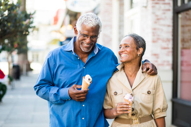 african american senior couple on the town with ice cream - geriatrics stock pictures, royalty-free photos & images