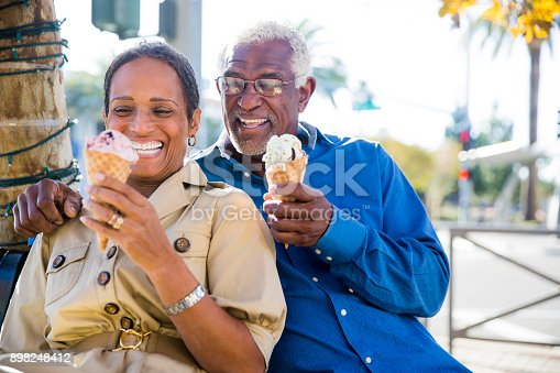 istock African American Senior Couple On the Town with Ice Cream 898248412