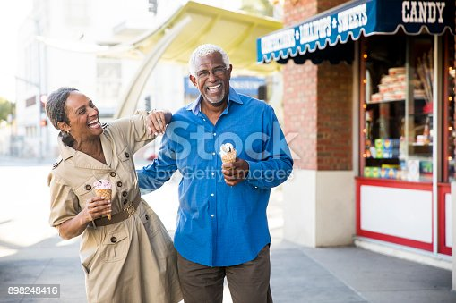 istock African American Senior Couple On the Town with Ice Cream 898248416