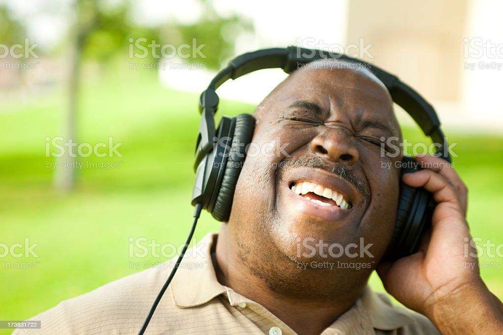 African American Senior Listening to Music stock photo