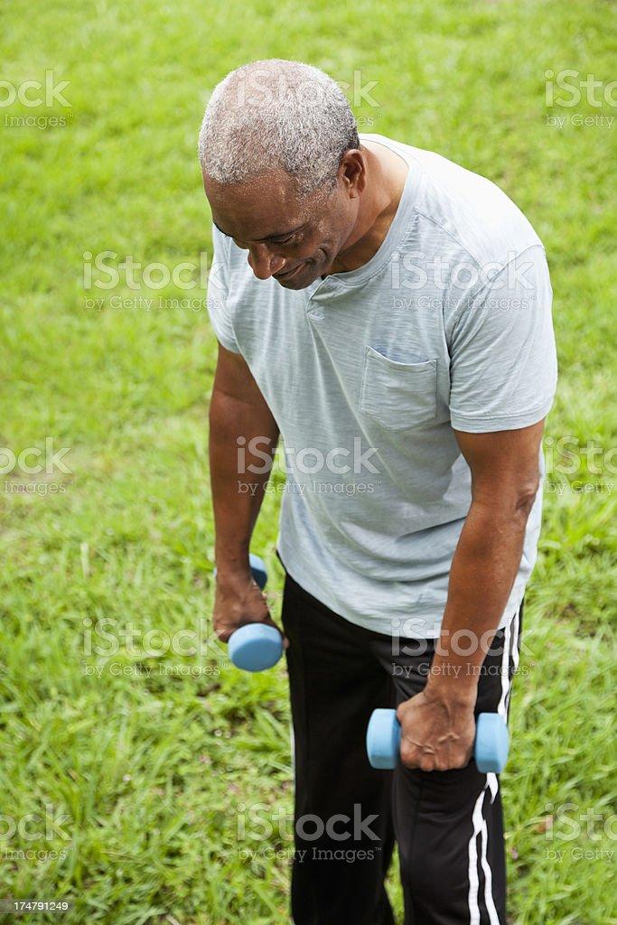 African American senior man exercising stock photo