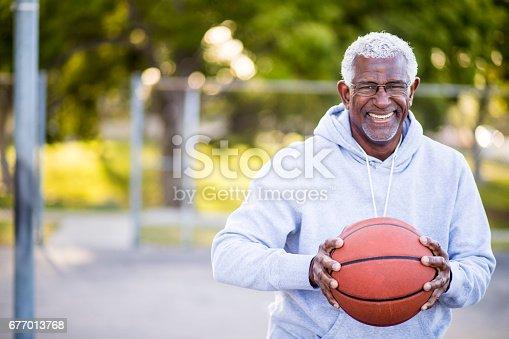 istock African American Senior Man with Basketball 677013768