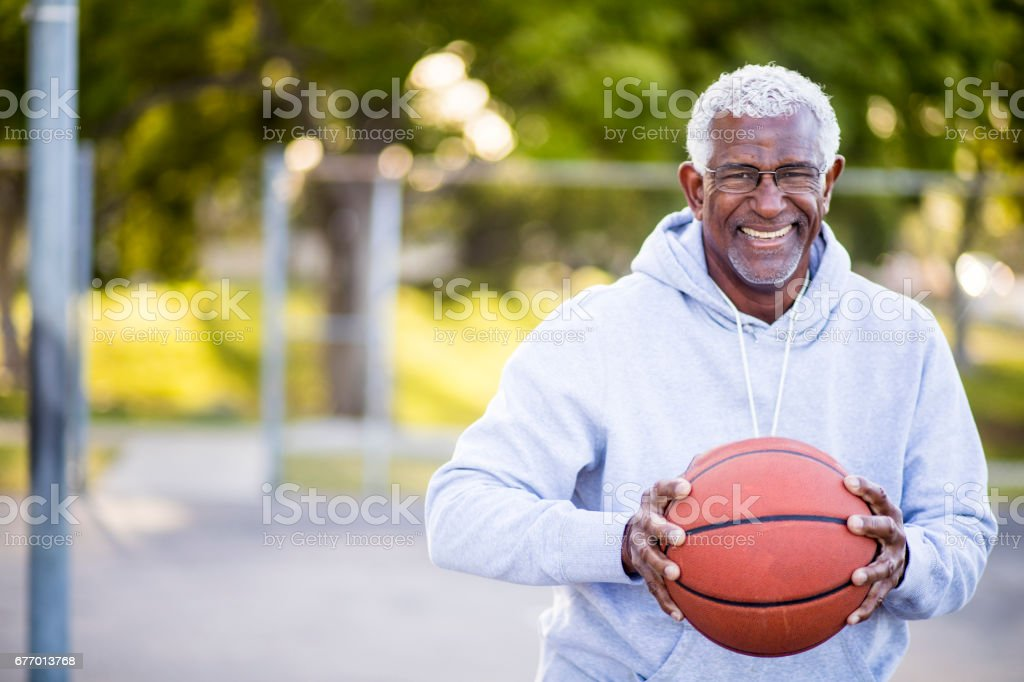 African American Senior Man with Basketball stock photo