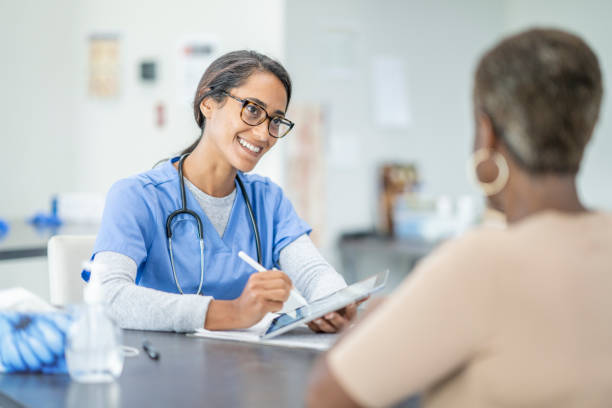 African American senior woman at medical appointment stock photo