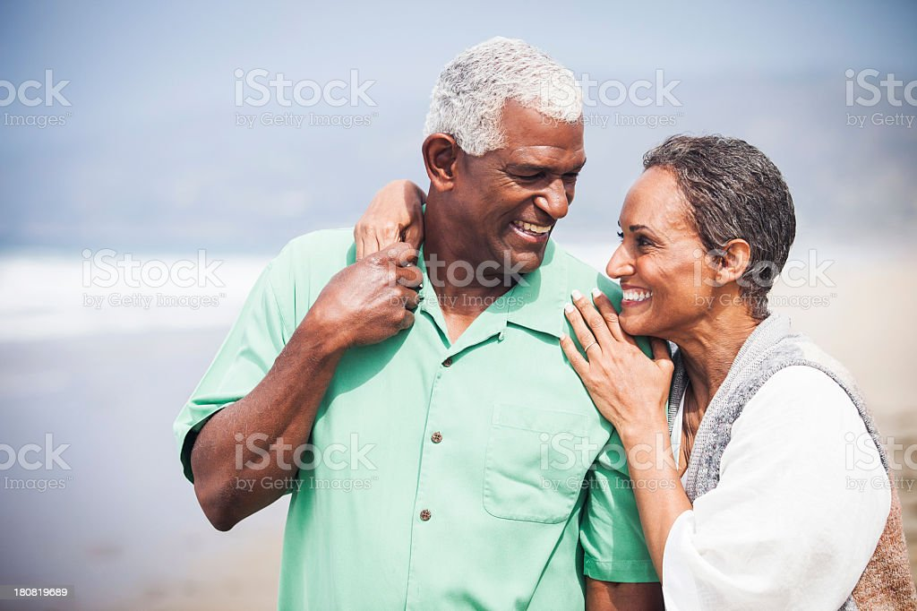 African American Seniors Smiling Together on Beach royalty-free stock photo