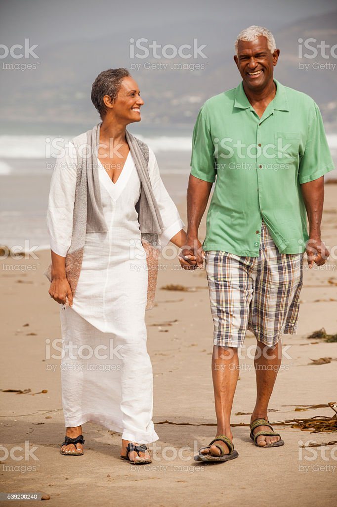 African American Seniors Together on Beach stock photo