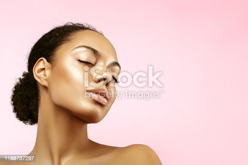 African American skincare models portrait. Beauty spa treatment concept.Young girl posing with closed eyes against pink background
