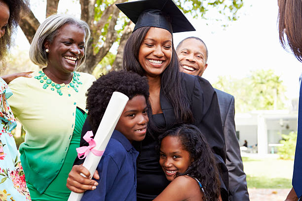 a04e7ff45b6 African American Student Celebrates Graduation stock photo