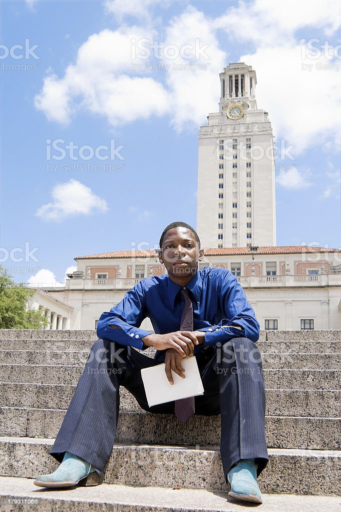 African American Student Sitting on Steps, University of Texas, Austin royalty-free stock photo