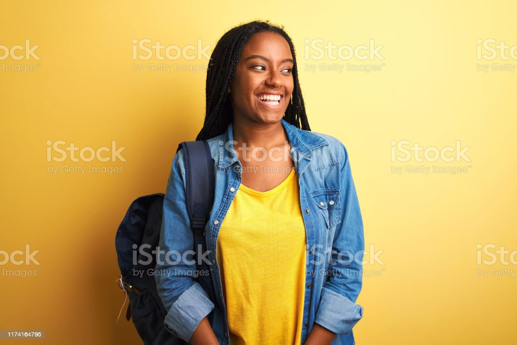 African american student woman wearing backpack standing over...