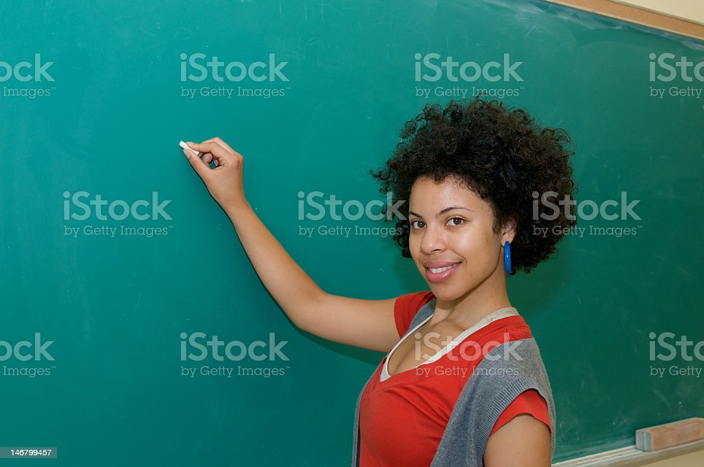 african american student writing on blackboard royalty-free stock photo