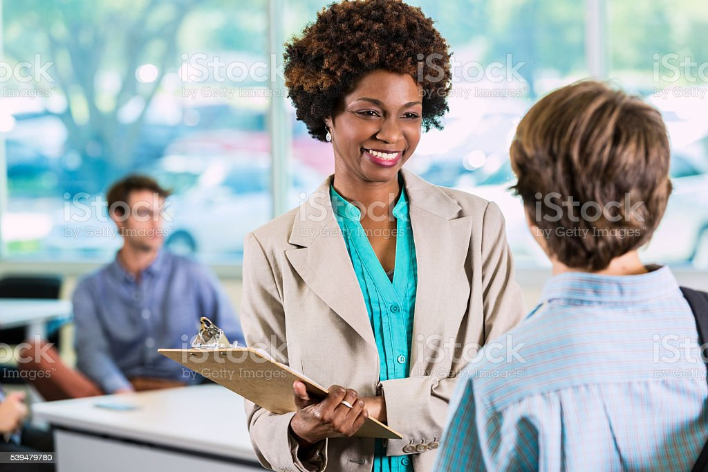 African American Teacher with student stock photo