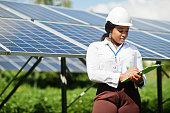 istock African american technician check the maintenance of the solar panels. Black woman engineer at solar station. 1271288766
