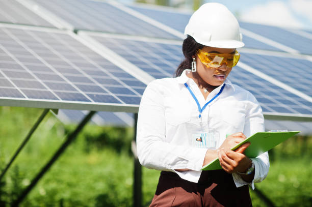 African american technician check the maintenance of the solar panels. Black woman engineer at solar station. stock photo