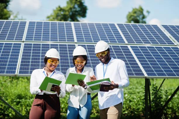 African american technician near solar panels. stock photo