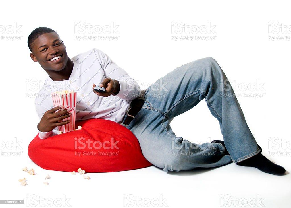 African American teen boy watching tv stock photo