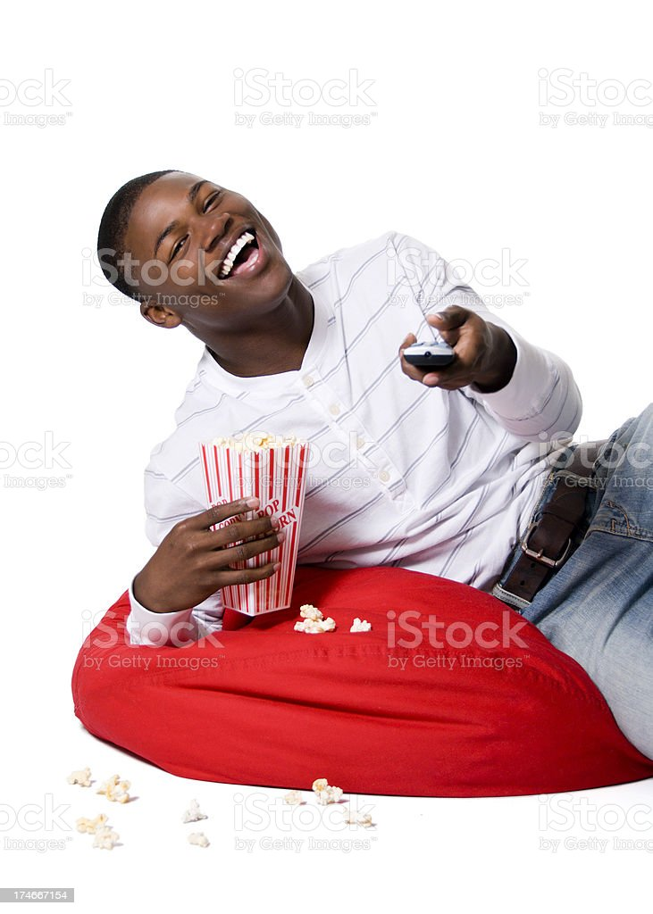 African American teen boy watching tv royalty-free stock photo