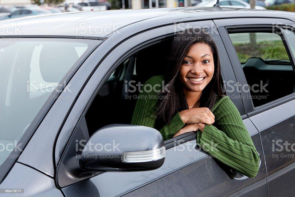 African American teenage girl driving car stock photo