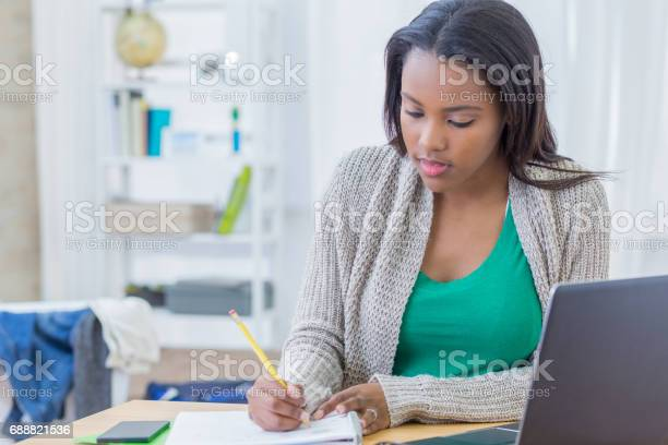 African american teenager concentrates while working on homework picture id688821536?b=1&k=6&m=688821536&s=612x612&h=ltem6orci8bknf5mydvcszjfonhopf5opsdtcorhlvq=
