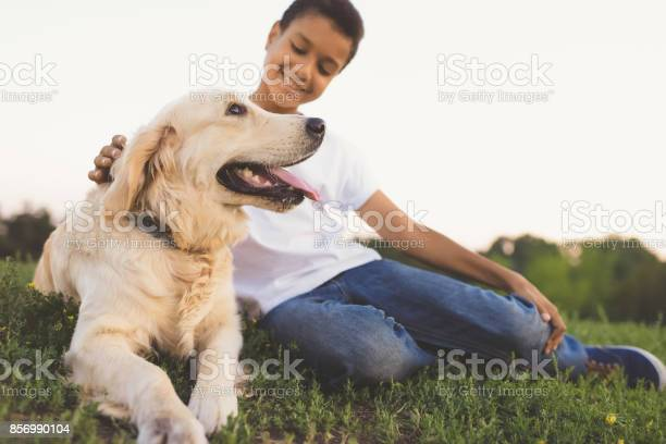 African american teenager with dog picture id856990104?b=1&k=6&m=856990104&s=612x612&h=jep6ioy4mzfyvqykwifjemmvo6lmxaaowrodb  z0re=