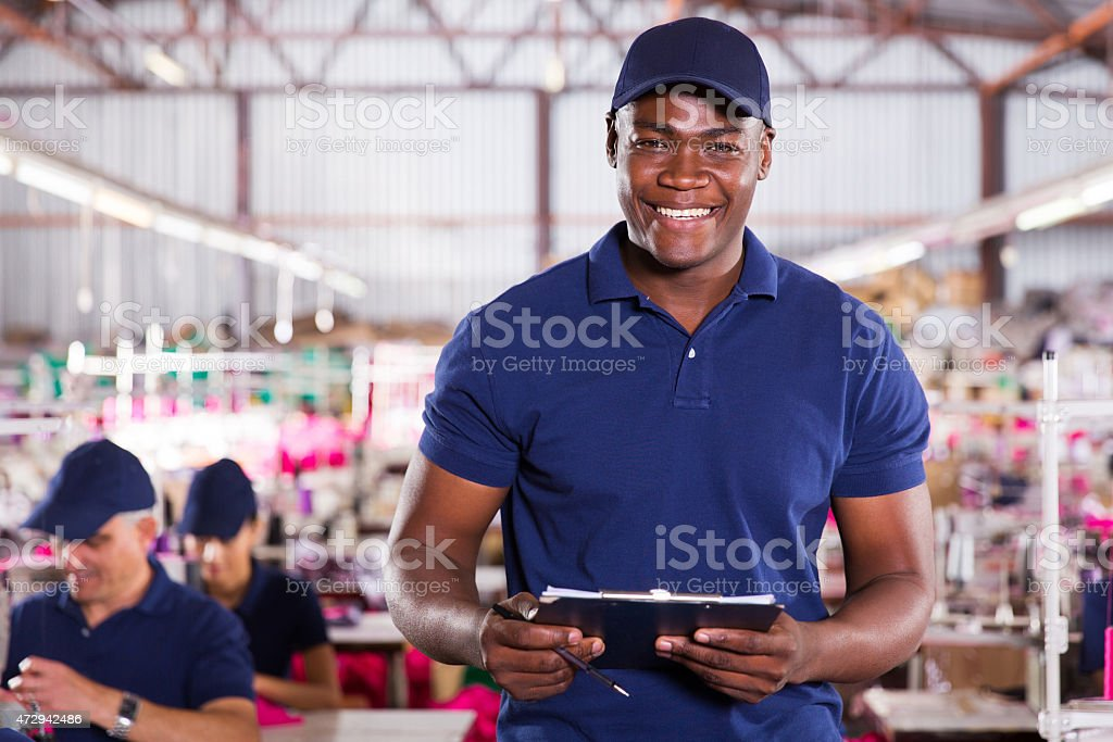 african american textile worker holding a clipcoad stock photo
