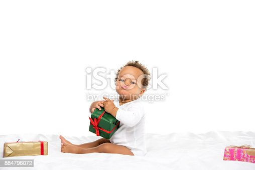 istock african american toddler with gifts 884796072
