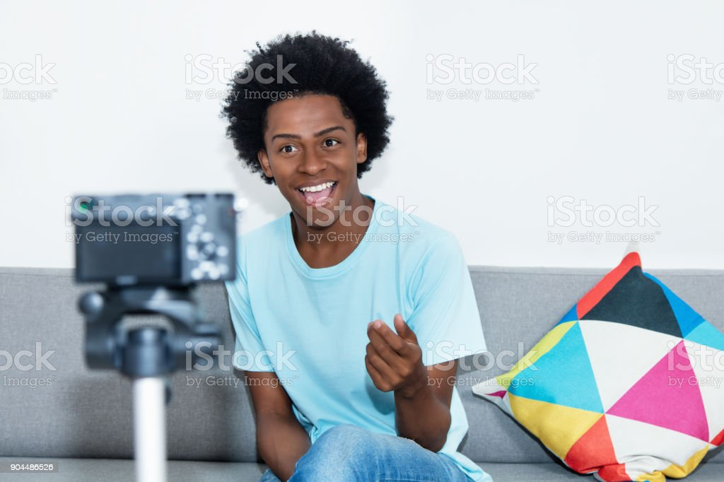 African american vlogger recording video blog stock photo