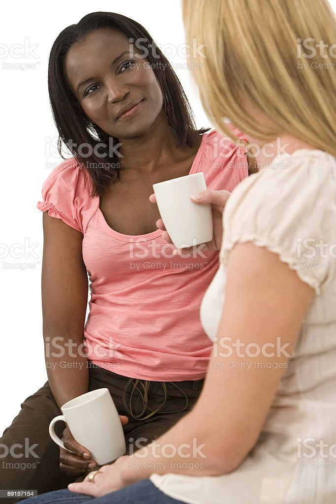 African American Woman and friend Chatting Over Tea or Coffee royalty-free stock photo